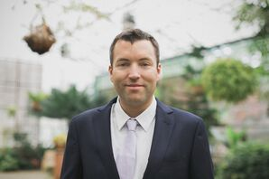 Groom in a Navy Suit and White Tie at Horticultural Center Wedding