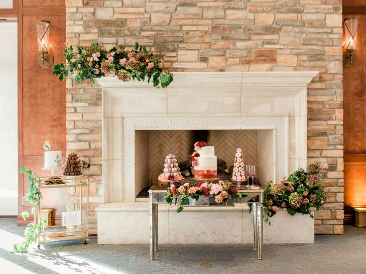 Romantic Dessert Table Near Fireplace with Flower Arrangements