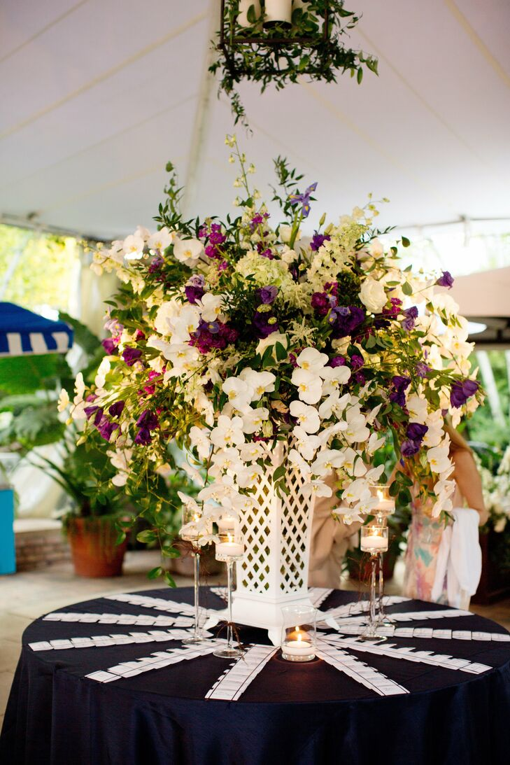 A large centerpiece of orchids, irises, stock and lisianthus sat on the escort card table.