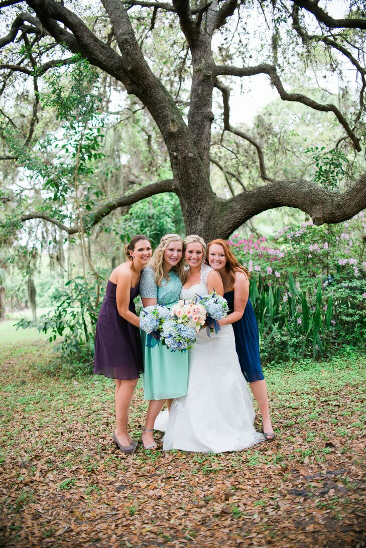 "After looking through paint swatches in Lowe's for two hours, Megan and her mother picked the couple's color palette. Each of the bridesmaids chose her own dress based on the couple's blue and purple wedding colors. ""I wanted everyone to feel good because when you feel good, you look good,"" says Megan."