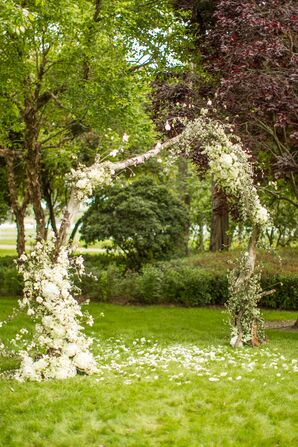 Whimsical Flower Arch With White Flowers