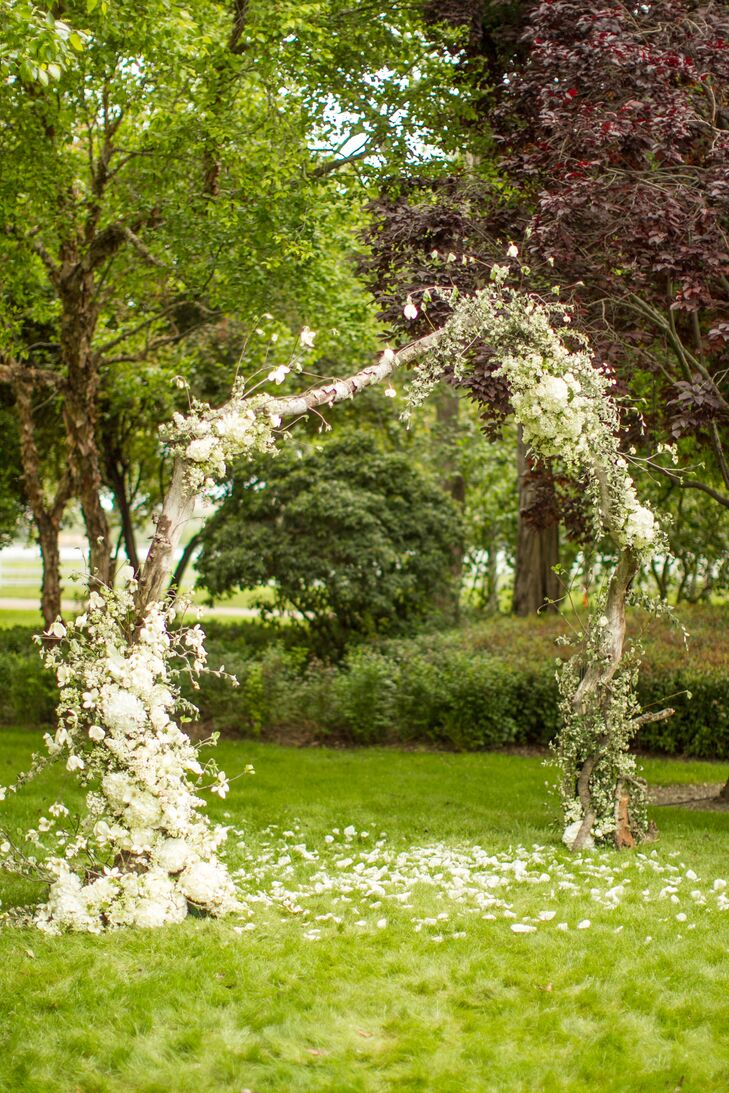 The ceremony structure was built by Tim's brother and adorned with flowers to look lush and organic.