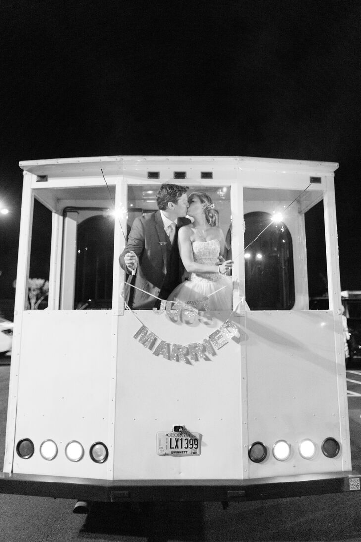 "A white trolley brought Kelsey, Andrew and their wedding party to and from the wedding. At the end of the reception, Kelsey and Andrew had a sparkler exit, but the night wasn't over. According to Kelsey: ""We really wanted to continue the party, so we invited all the wedding party and some friends onto the trolley to downtown Athens to continue the celebration."""