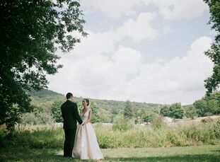 Michele Fernandez and David Edelman planned a chic rustic soiree in the rolling hills of Blooming Grove, New York, for their early-August wedding. Wit