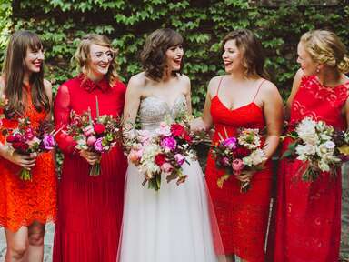 Mismatched Bridesmaid Dresses in Red, Orange and Pink