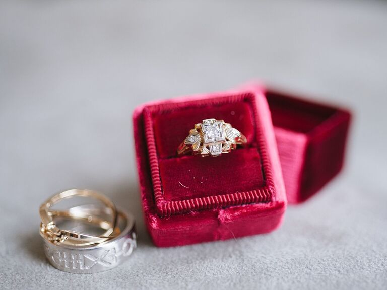 Vintage art deco engagement ring in box with wedding bands