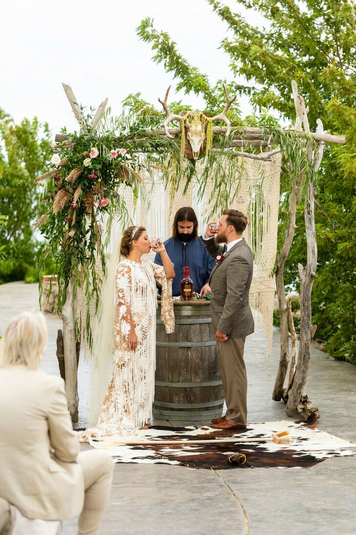 Bohemian Ceremony with Wine Barrel, Macramé Draping and Driftwood Arch