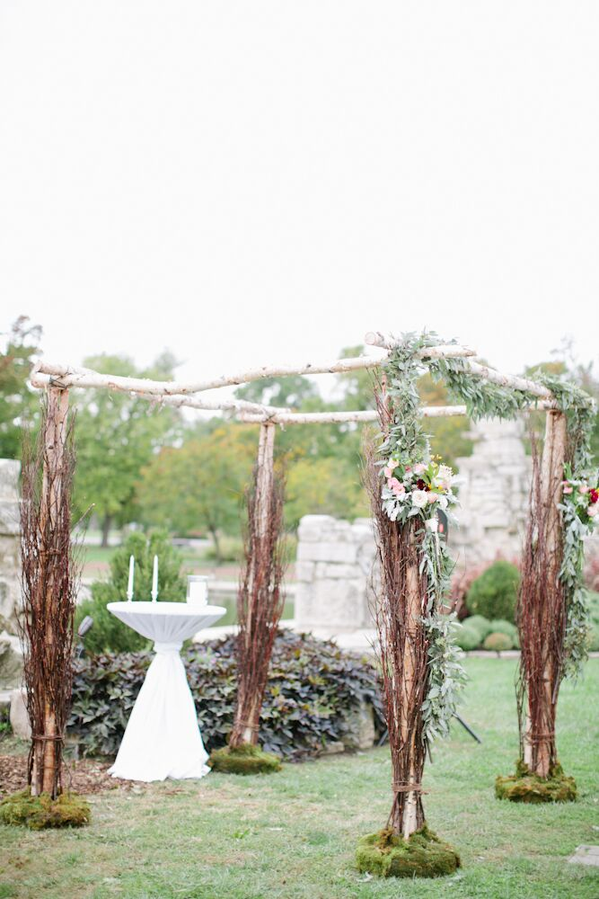 Jessica and Bassey exchanged vows at the ruins in Tower Grove Park in St. Louis, Missouri. Since the location was gorgeous on its own, the couple kept their decor natural and organic. Their chuppah was made of unfinished tree branches adorned with olive branches, garden roses and leafy garlands.