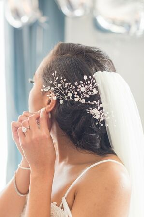 Bride Putting on Earrings for Wedding at The Faulkner in Jackson, Mississippi