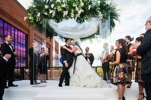 Modern Rooftop First Kiss with Acrylic Wedding Arch and Leaves