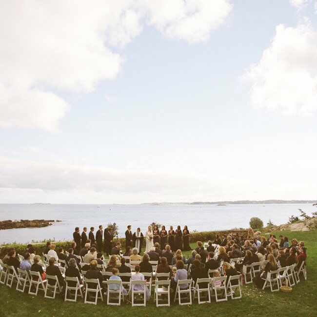 Surrounded by views of the ocean, Elizabeth and Matthew exchanged vows on the grass at Misselwood. Guests sat in a semicircle of chairs around the altar, which was demarcated by large, wrought iron urns filled with flowers and curly willow