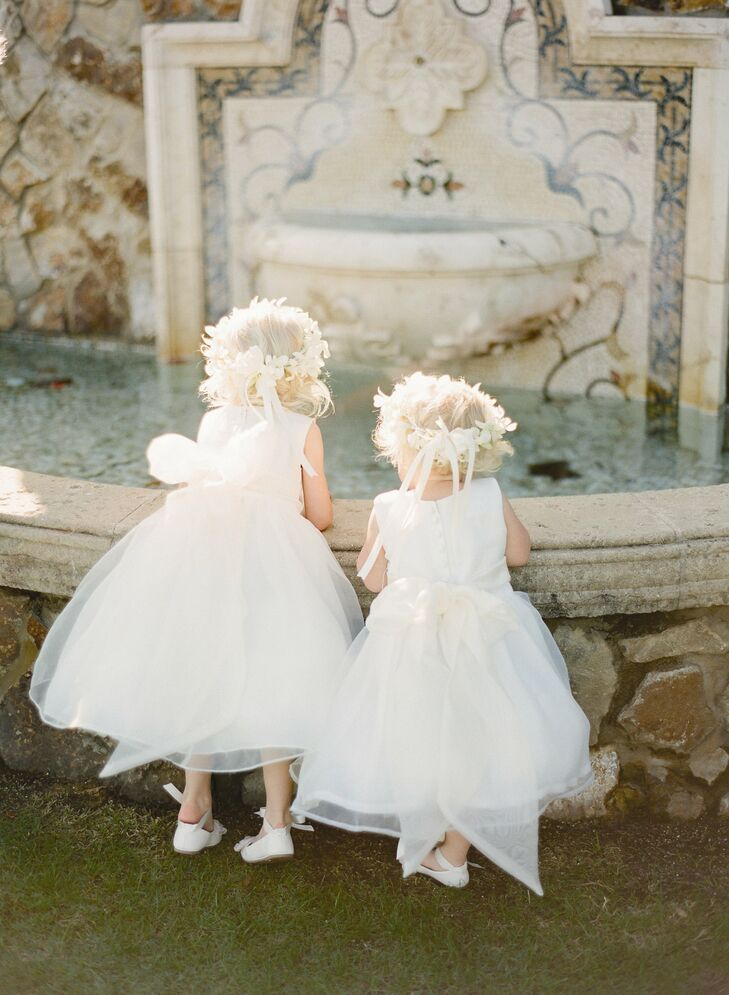 The flower girls dresses mirrored Jessica's own gown, with full organza skirts.