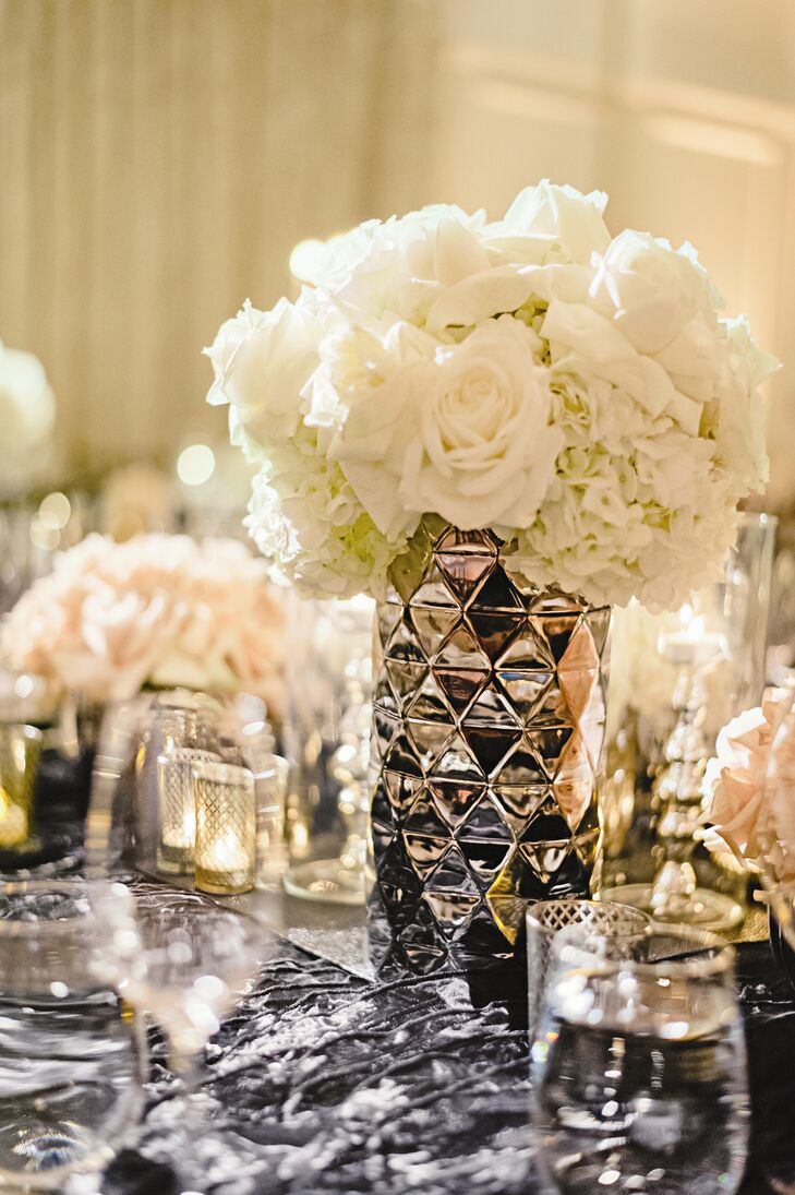 Tight arrangements of cream roses and hydrangeas were reminiscent of the dramatic folds in Brittney's bustled skirt.