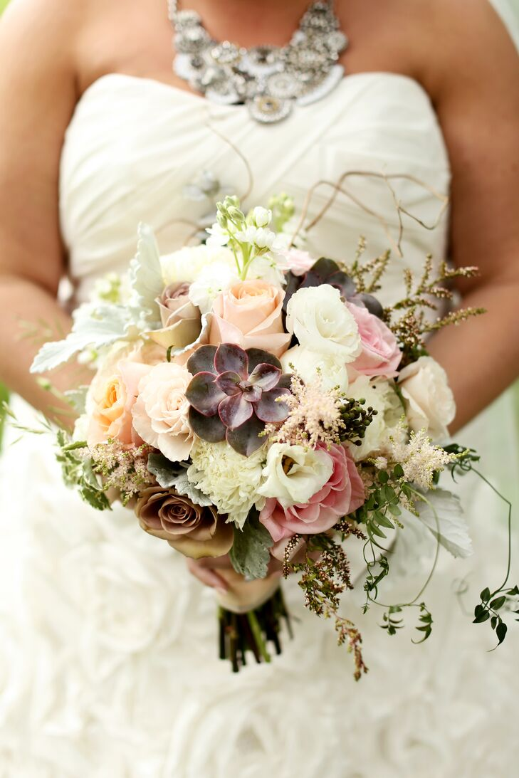 Toni's Flowers created a gorgeous, textured arrangement for Katie to carry down the aisle. The bouquet included purple succulents, blush roses, white lisianthus and blush astilbes.