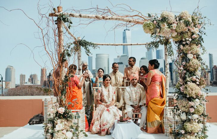 Elegant Hindu Ceremony Beneath Birch Mandap Covered with Romantic Flowers