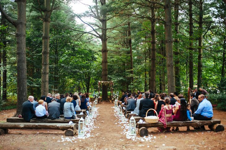 Claudia knew she wanted a forest wedding, so the couple exchanged vows outdoors surrounded by lush trees.
