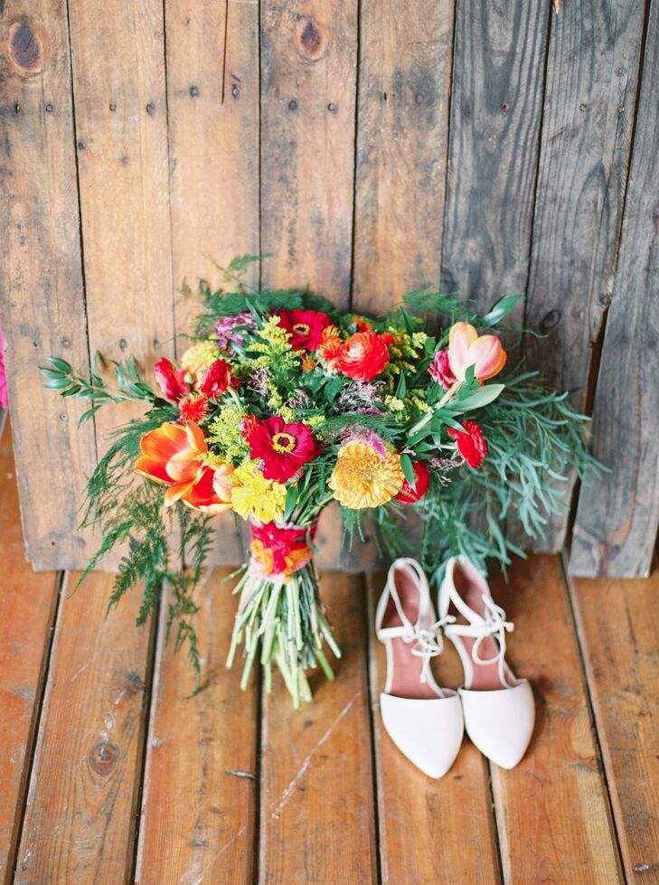 In order to explore the Rodale Institute's Kutztown, Pennsylvania, fields, Courtney opted for a pair of flat ivory shoes from Jeffrey Campbell. Her bouquet consisted of pink, orange and yellow dahlias, celosia, zinnias, ranunculus, limonium, tulips, freesia, stock, asters, safflowers, nagi, plumosa and eucalyptus feathers.