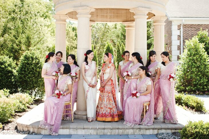 All of the bridesmaids donned mauve-pink saris.