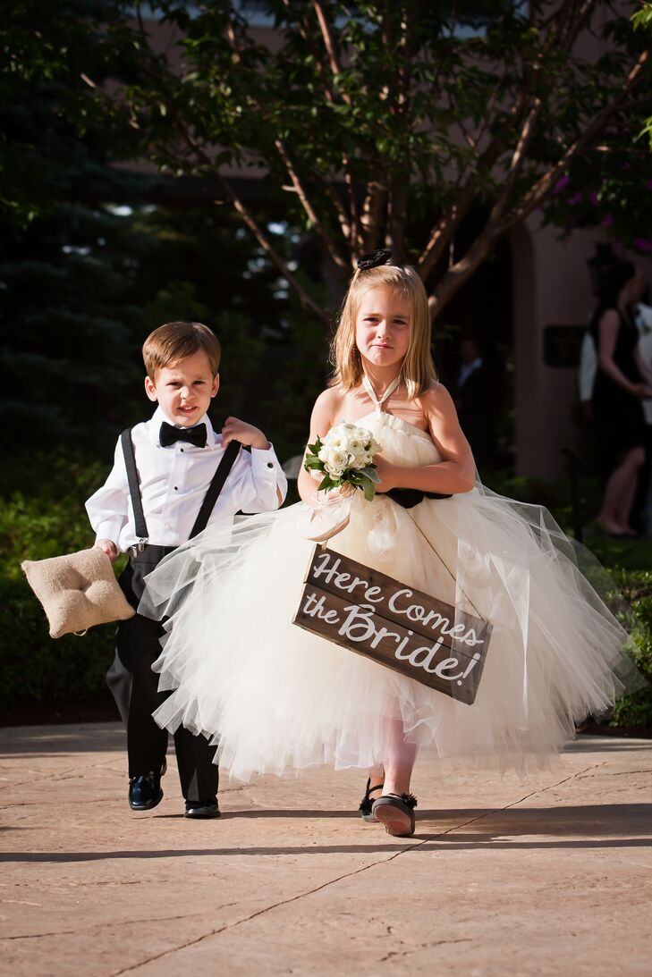 The flower girl wore a white tulle dress from Etsy, and the ring bearer rented his tuxedo from Men's Wearhouse.
