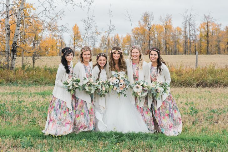"""Traditional wasn't going to cut it as far as Julia's bridesmaid dresses were concerned. From day one she had envisioned her attendants walking down the aisle in flowy floral frocks, but finding the right dress proved to be a challenge. """"We initially purchased ivory floor-length dresses from H&M because we didn't want to panic as time went on,"""" Julia says. """"On a trip to Banff National Park, I spotted two floral dresses in a boutique, then found the remaining two online."""" They paired the gowns with cozy cardigans, brown flats and flower crowns for a romantic, bohemian feel."""
