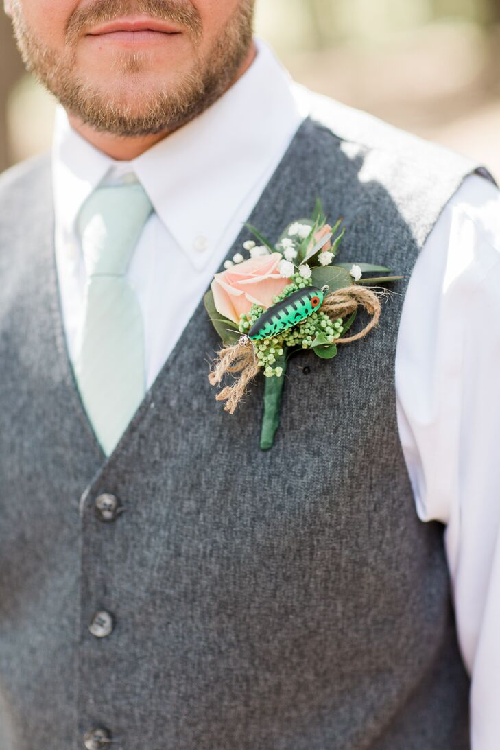"""Chris loves fishing. It was a perfect touch,"" Karley says of the vintage fishing lures that were incorporated into the men's boutonnieres."