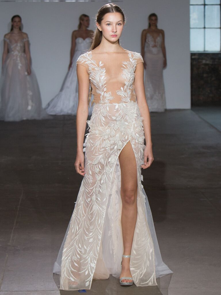 Adam Zohar Spring 2019 Collection sheer A-line wedding dress with dramatic front slit and illusion plunging V-neckline and leaf appliqué
