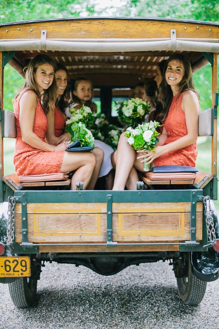 """Adding an extra-personal touch to their day, Cam's 12 bridesmaids rode to their ceremony in a vintage family car. """"When my cousins and I were younger, my grandfather acquired an antique REO Speed Wagon to carry the grandchildren to steeplechase races and other family events,"""" Cam says. """"My bridesmaids rode to the wedding in the REO."""" How cool is that!"""