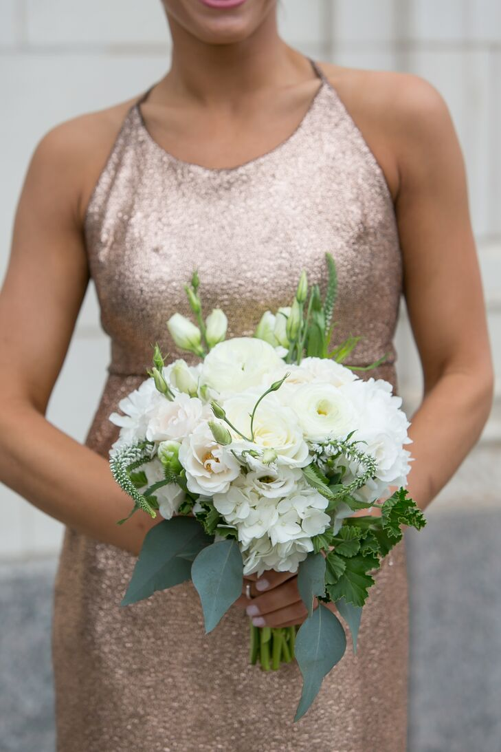 The bridesmaids carried hydrangeas, veronica, roses, lisianthus and peonies in their all-white bouquets. With their super-sparkly gold dresses, Allie and Liam didn't want  the flowers to compete for attention. Plus, Allie loved how the neutral bouquets matched her look.
