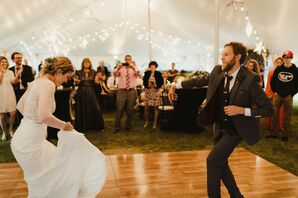 First Dance at Tented Reception with String Lights and Hanging Stars
