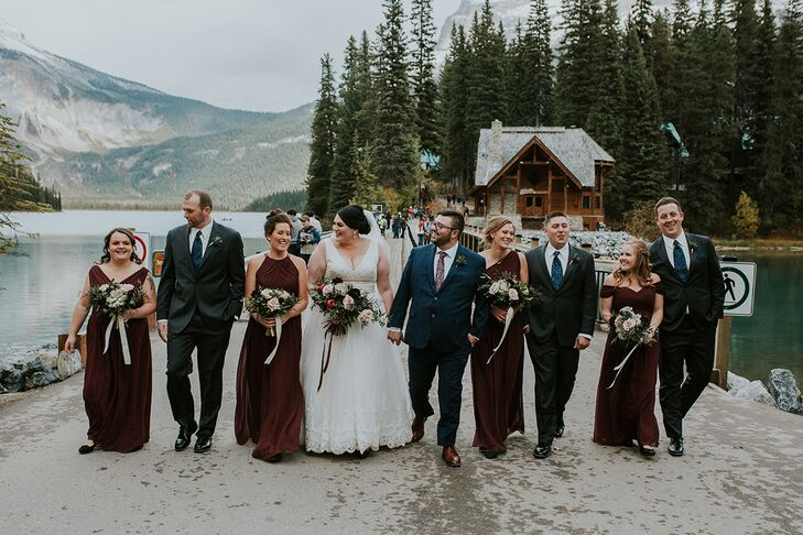 Rustic Wedding Party Wearing Burgundy Gowns and Black Suits