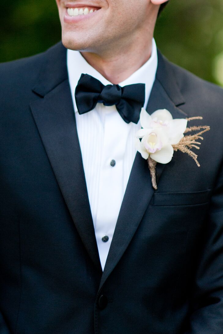 Lou's boutonniere featured a small arrangement of white orchids.