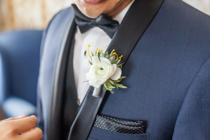 White Ranunculus and Succulent Boutonniere