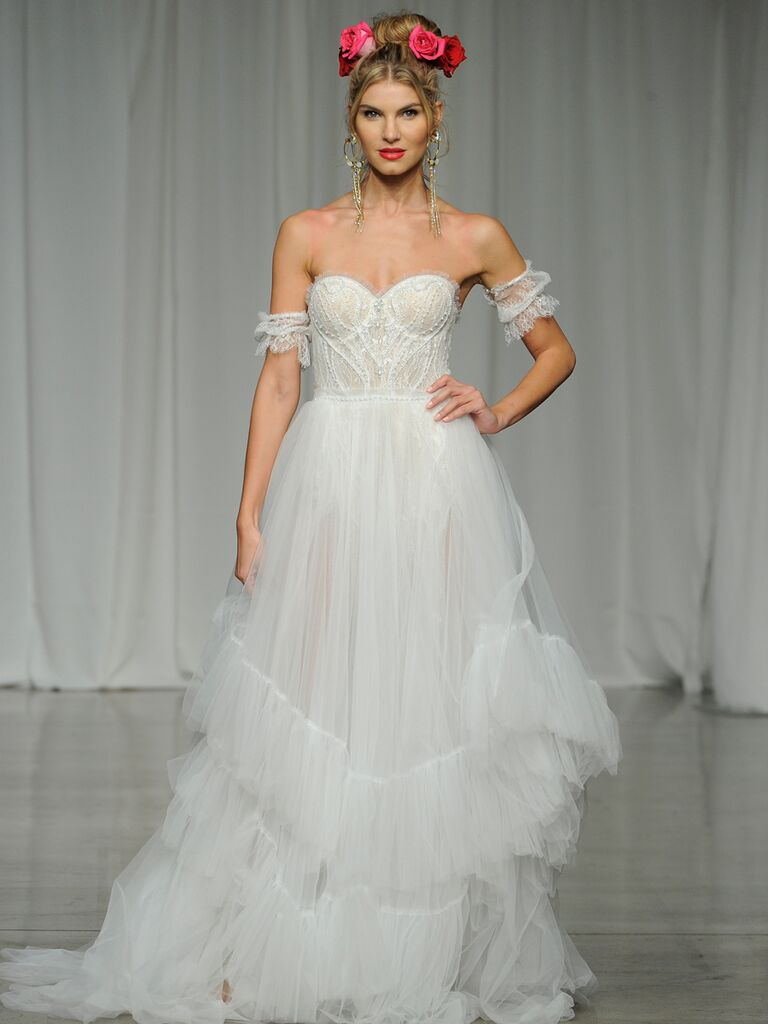 Julie Vino Spring 2019 wedding dress with a corseted bodice, ruffled tule skirt and lace shoulder details