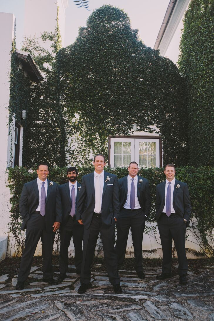 The groomsmen and groom wore charcoal gray suits from JoS. A. Bank with white shirts and purple ties. Russ stood out with a white satin tie.