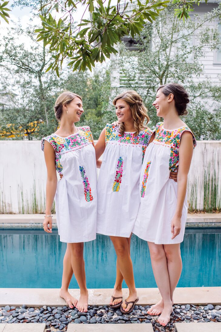 Caroline and Christopher had a large wedding party, but her sisters stood out before and during the wedding. They all got ready together in floral baby-doll dresses with mosaic-inspired patterns along the high neckline. Later, the bridesmaids switched out their looks for navy dresses.