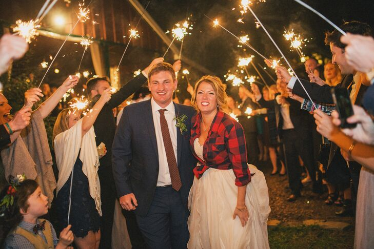 While the couple spent their wedding night at Glen-Ella Springs Inn in Clarkesville, Georgia, the new Mr. and Mrs. Bowden dressed comfortably, with the bride donning a flannel shirt over her dress. They later joined their loved ones at a bonfire after the reception.