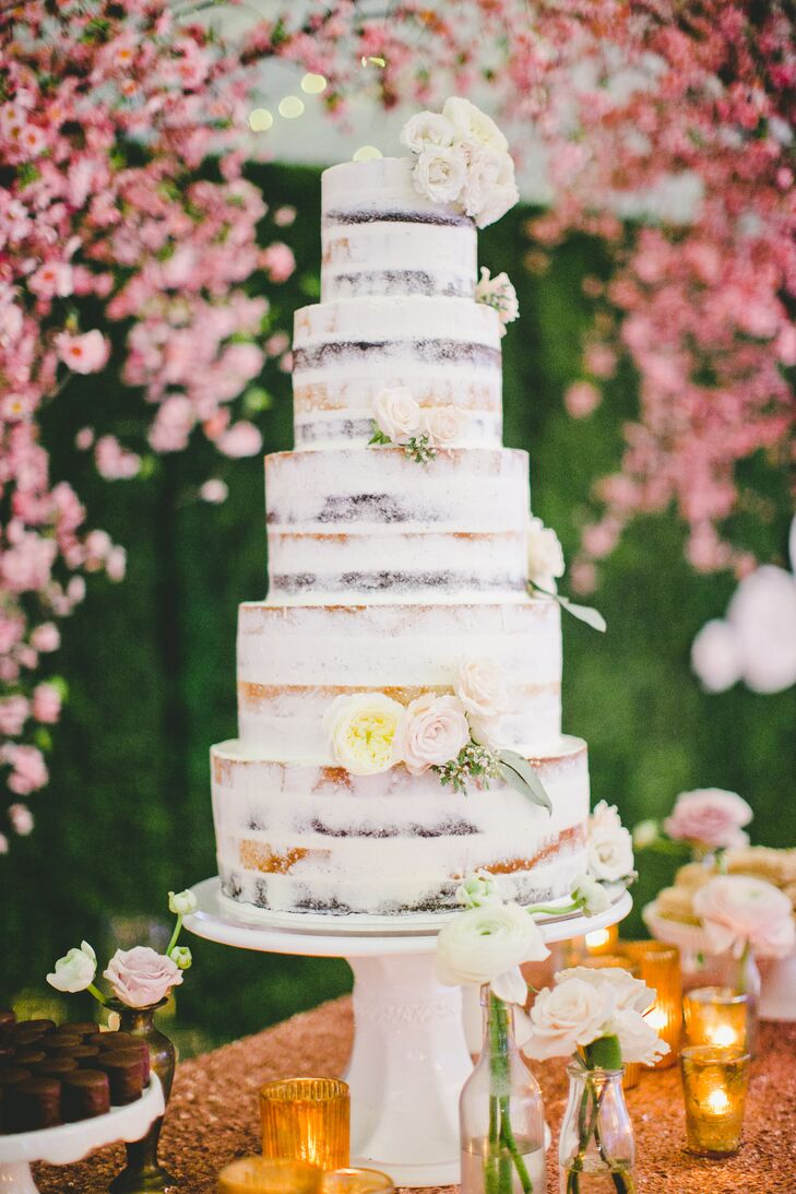 Despite the other small goodies served throughout the day, nothing compared with the five-tier naked cake dusted with white and accented with fresh blooms. The entire dessert stood on top of a simple white stand.