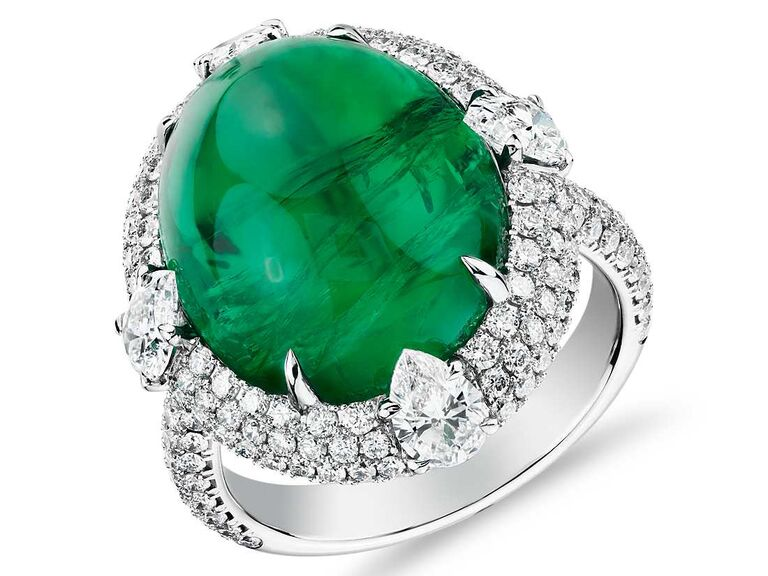 Emerald ring with triple diamond halo and tiger prongs