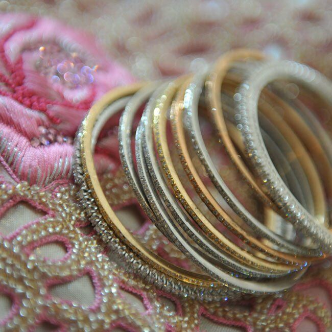 In addition to traditional mehndi (henna tattoos), Dolci wore sparkling bangles on her wrists.