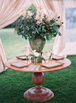 Eucalyptus and Orchid Floral Arrangement in Stone Urn