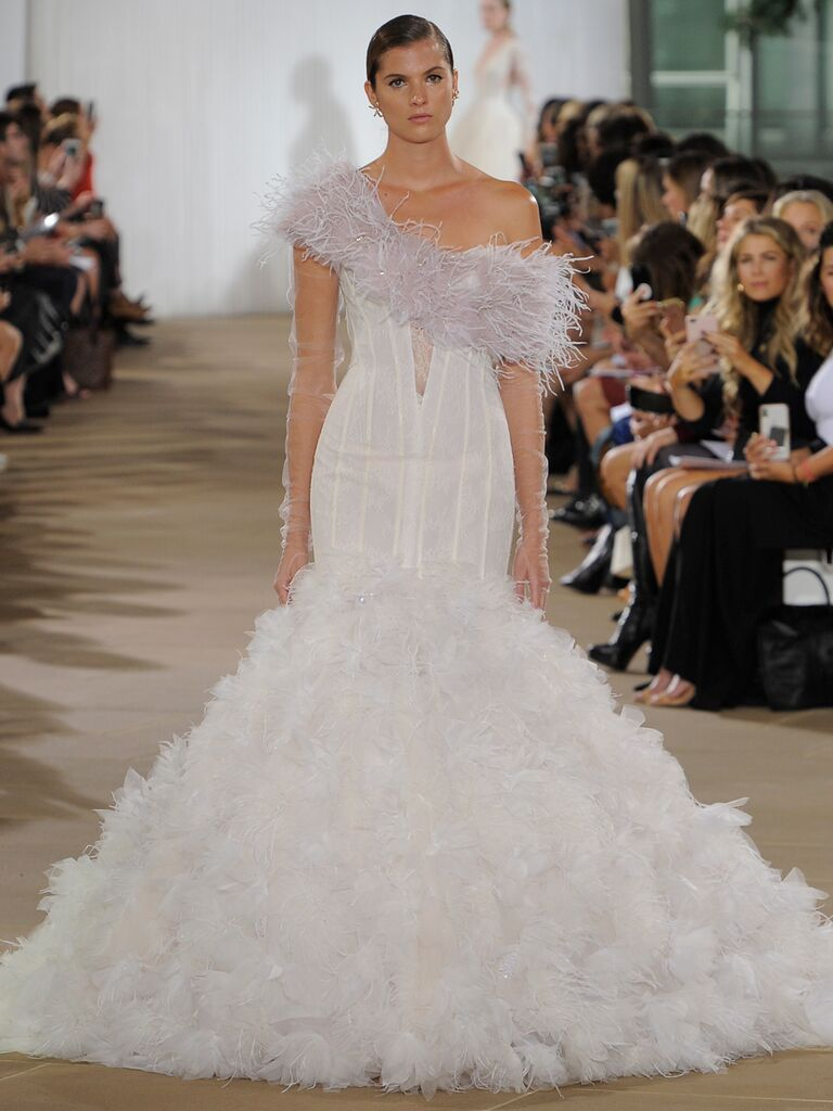 Ines Di Santo Fall 2019 glamorous asymmetrical wedding dress with feathered bodice and mermaid skirt