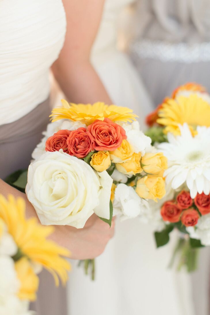Bouquets at Leah and Adam's wedding included roses and gerbera daisies in shades of white, yellow and orange.