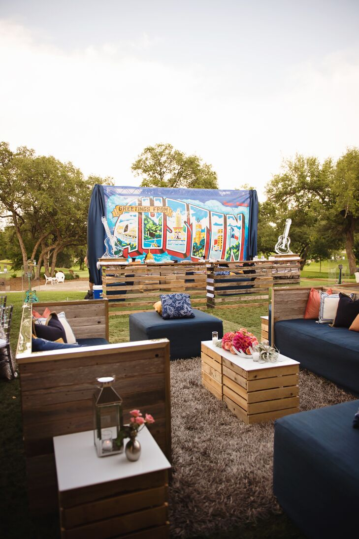"""The lawn provided a relaxing spot to soak up the Austin, Texas, ambience. Casual lounge furniture with plenty of pillows, a wooden bar with a custom """"Greetings From Austin"""" banner backdrop and even a guitar-shaped glass sculpture (for martinis) channeled the laid-back scene."""