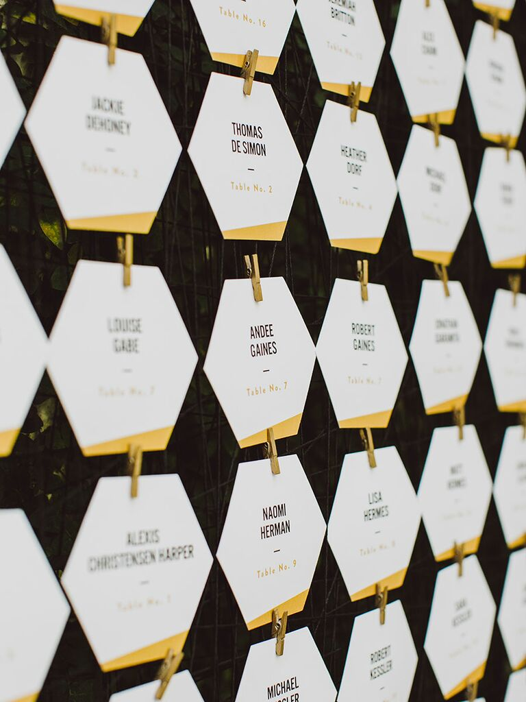 Modern escort card ideas geometric and gold