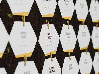 Modern escort card ideas geometric and gold