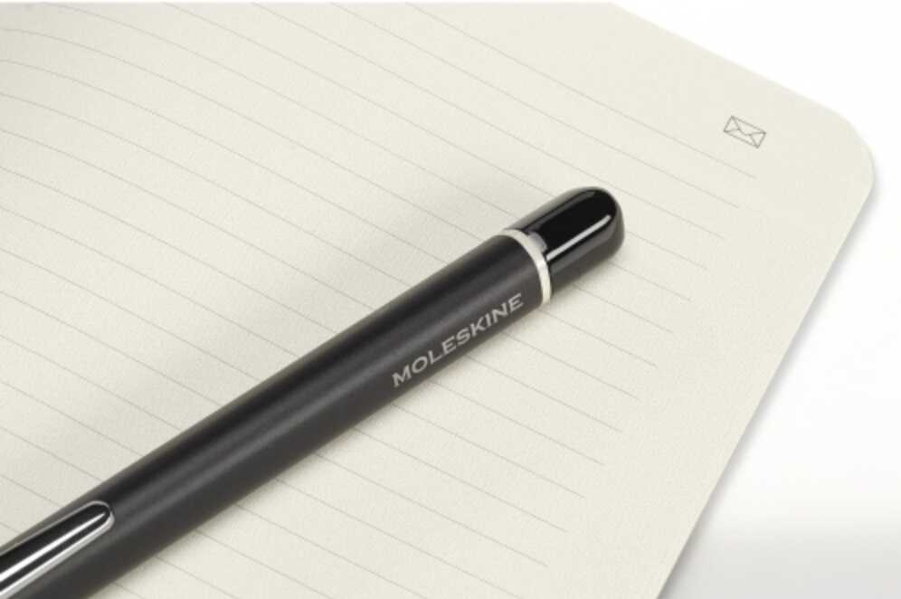 moleskine notebook with pen