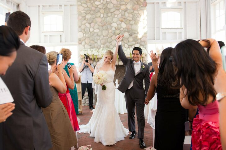 Nadia wore a trumpet gown with delicate lace embroidery, crystal accents and a traditional scalloped lace veil. Joseph wore formal gray tuxedo for a classic, polished look.