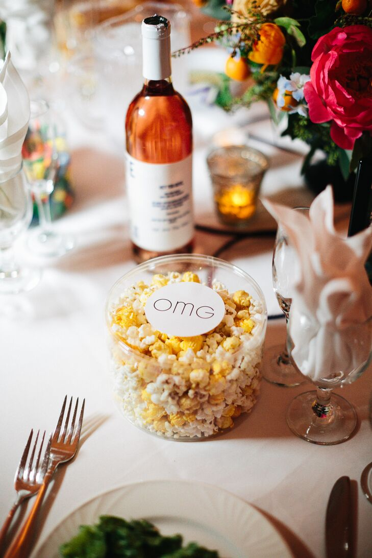 In keeping with the movie theme, Liz and Adam equipped each place setting with a mini tub of popcorn that guests could snack on throughout the evening.