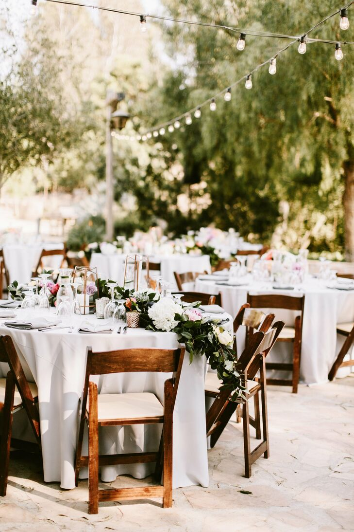 "String lights added ambiance to the outdoor reception at Leo Carrillo Ranch in Carlsbad, California. ""I wanted the whole day to feel like a casual yet elegant dinner party filled with love, laughter and lots of dancing,"" Mira says."