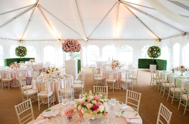 Using boxwood hedges, topiaries and three custom-designed tablescapes, the couple's garden vision was captured during their tented reception.